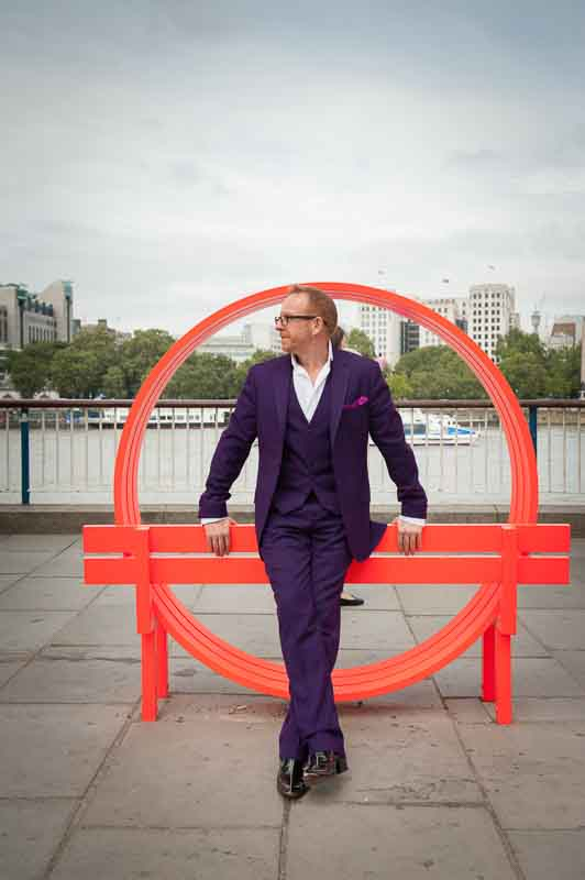 Personal branding image of comedian in purple suit